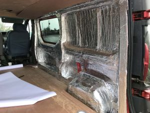 Foil insulation on the inside of the camper conversion