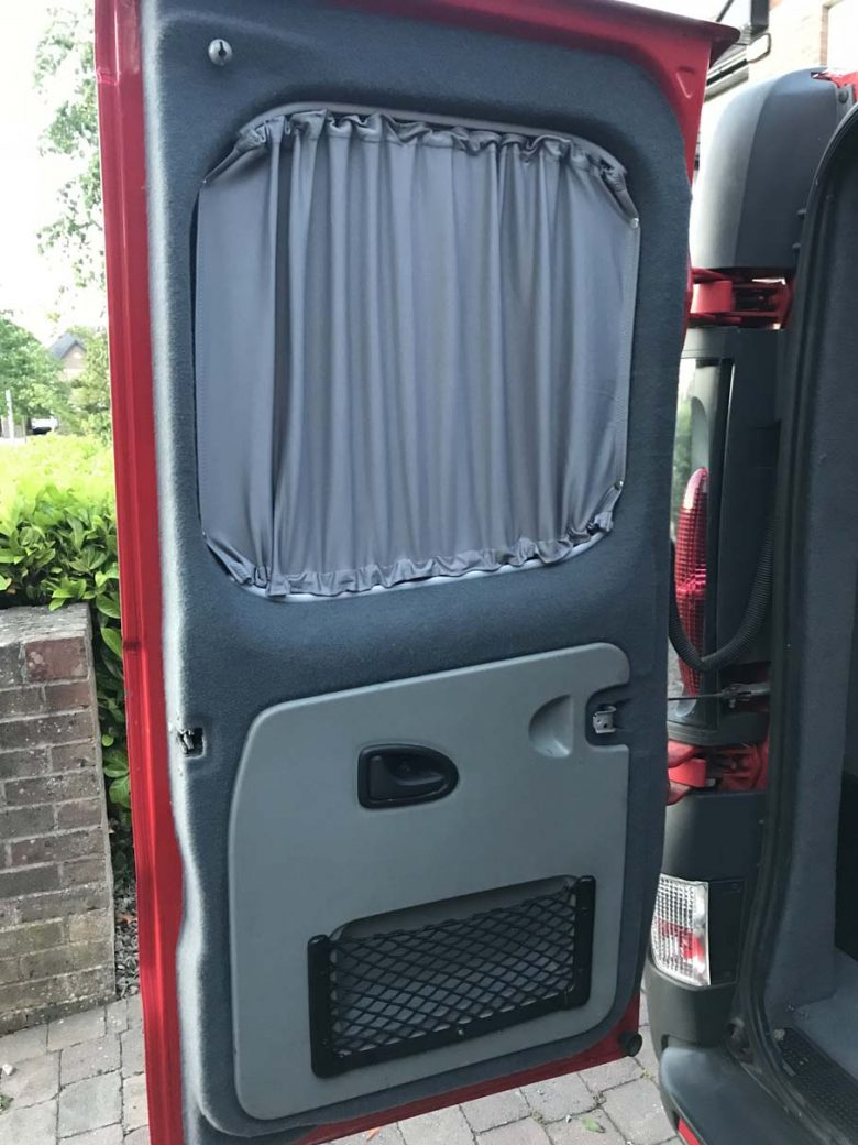 The rear door interior with fabric lining