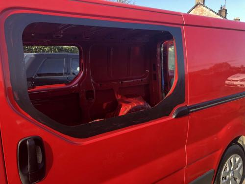 Window opening cut in side of camper van